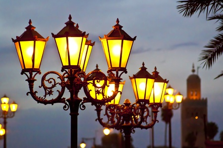 Street lights in Marrakesh with Koutoubia Mosque near Jemaa El Fna in the background. photo