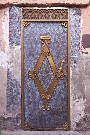 Private house entrance in maroccan medina photo