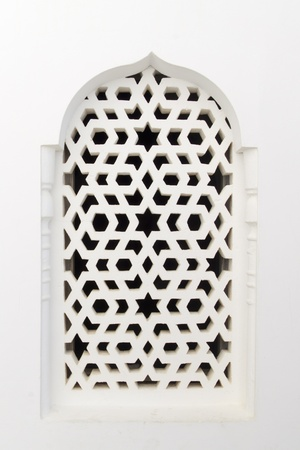 stucco house: Traditional maroccan window, with a typical arabic ornament