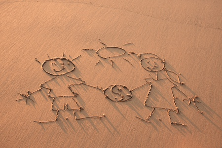 family unit: Drawn in the sand on the atlantic coast