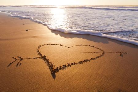 heart break: Heard drawn in the sand on the atlantic coast