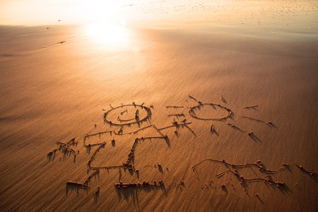 Drawing in the sand on the atlantic coast photo