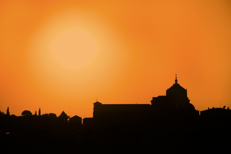 Silhouette of catholic church in Toledo, UNECO protected town in Spain photo