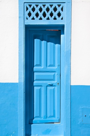Traditional light blue, vintage, wooden, mediterranean door. photo