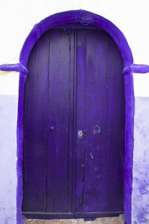 Traditional violet, vintage, wooden, mediterranean front door. photo
