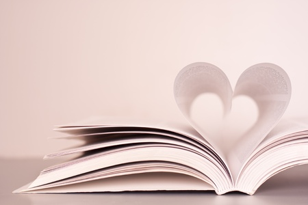composition book: Pages of a book forming the shape of the heart.