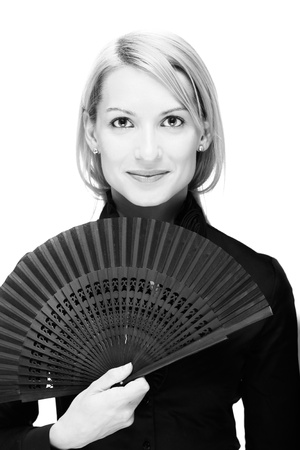 Portrait of a successful,  elegant, atractive, business woman wearing black blouse holding folding fan. photo