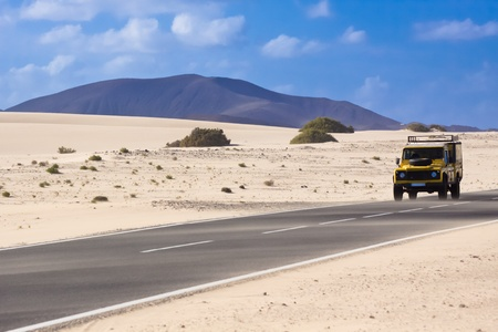 Jeep on the road crossing the desert. photo