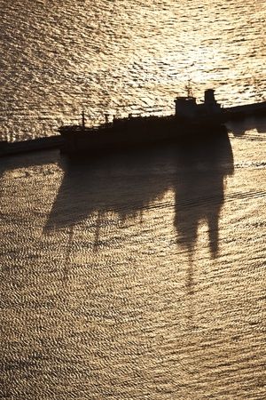 Large container ship in a dock at Gibraltar harbor photo