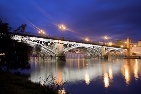 Panorama of Seville riverside at down under the Triana Bridge, the oldest bridge of Seville Stock Photo - 12961742