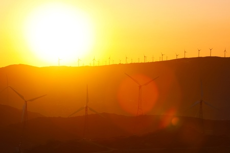 Wind turbines farm at sunset in southern Spain. photo