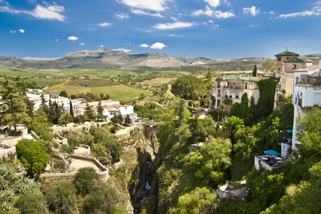 Panoramic view from a new bridge in Ronda, one of the famous white villages in Andalusia, Spain Stock Photo - 9711231