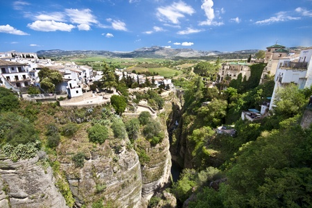 Panoramic view from a new bridge in Ronda, one of the famous white villages in Andalusia, Spain Stock Photo - 9711232