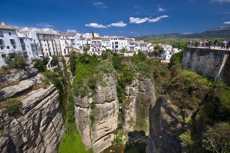 Panoramic view from a new bridge in Ronda, one of the famous white villages in Andalusia, Spain Stock Photo - 9711198