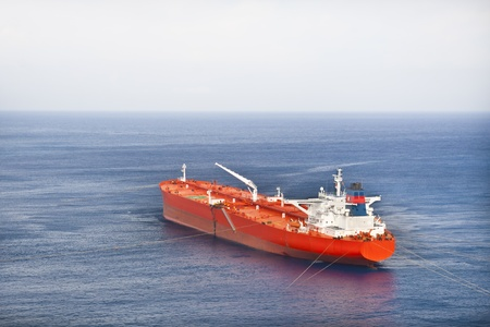 a big ship: Red oil tanker
