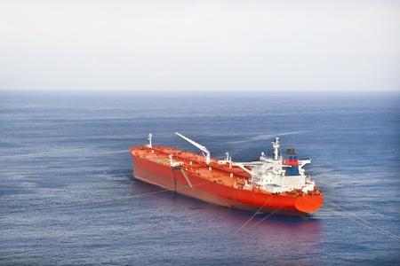 blue vessels: Red oil tanker