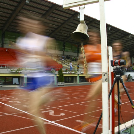 A motion blur of the runners crossing the finish line. Stock Photo - 9711243