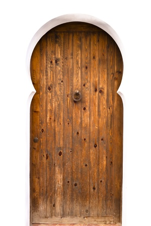Traditional moorish style wooden door in a white background photo