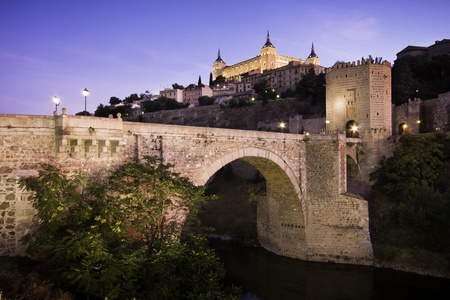 Panorama of the alcazar above the medieval San Martin bridge - Toledo, Spain Stock Photo - 9829527