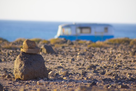 An old, rusty, vintage, surfing, camping, van on the coast. photo