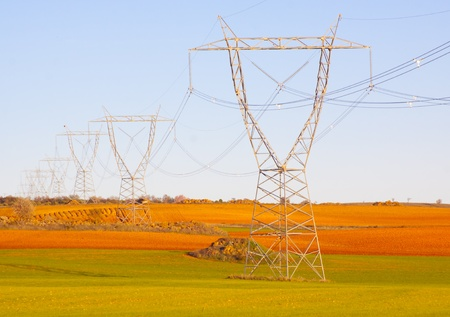 High tension transmission lines crossing the colorful fields of Spain  photo