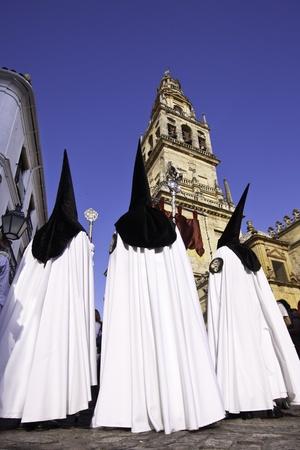 semana santa: The extraordinarily  Christianprocession of the Semana Santa  Holy Week  in Cordoba, Spain  Editorial