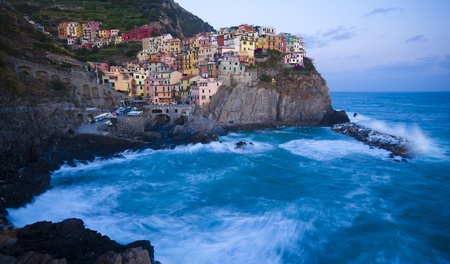 Manarola fisherman village in a dramatic wind storm  Manarola is one of five famous villages of Cinque Terre  Nationa park , suspended between sea and land on sheer cliffs upon the wild waves  photo