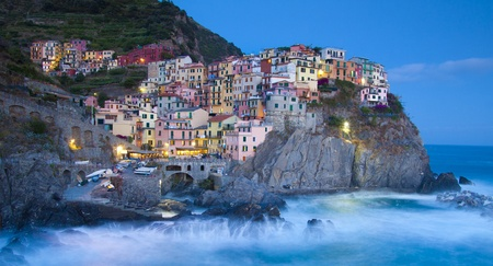 Manarola fisherman village in a dramatic wind storm. Manarola is one of five famous villages of Cinque Terre (Nationa park), suspended between sea and land on sheer cliffs upon the wild waves. photo
