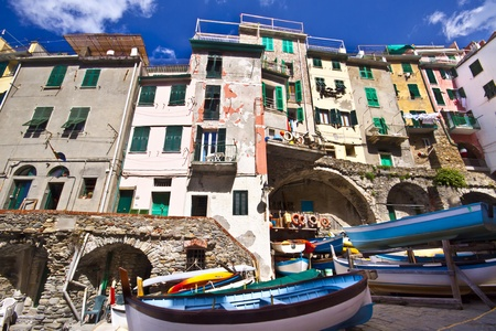 Riomaggiore fisherman village in a dramatic windy weather  Riomaggiore is one of five famous colorful villages of Cinque Terre in Italy, suspended between sea and land on sheer cliffs upon the  turquoise sea