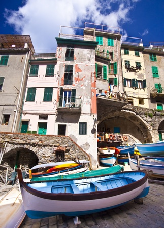 Riomaggiore fisherman village in a dramatic windy weather  Riomaggiore is one of five famous colorful villages of Cinque Terre in Italy, suspended between sea and land on sheer cliffs upon the  turquoise sea  Stock Photo - 12943969