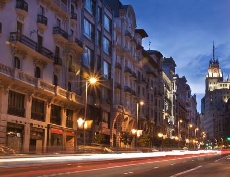 Rays of traffic lights on Gran via street, main shopping street in Madrid at night. Spain. photo