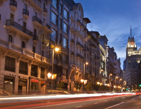 old center: Rays of traffic lights on Gran via street, main shopping street in Madrid at night. Spain.