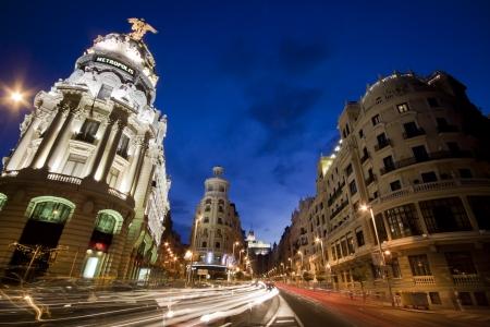 Rays of traffic lights on Gran via street, main shopping street in Madrid at night. Spain. Stock Photo - 10578130