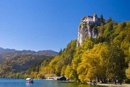 slovenia: Colorful Bled in fall, with the rock top castle in the background. Slovenia