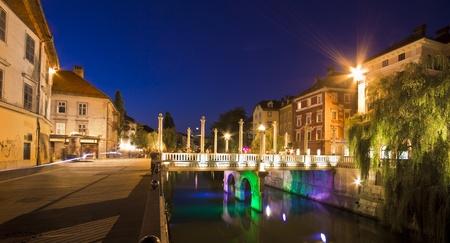 Shoemakers bridge (Cevljarski most) and medieval houses in Ljubljana historical city centre. photo