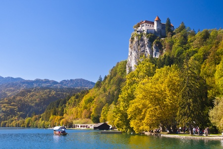 Colorful Bled in fall, with the rock top castle in the background. Slovenia photo