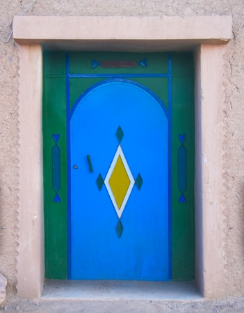 Colorful moroccan rural door with traditional pattern. photo