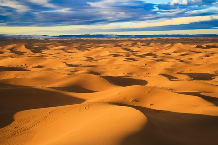 Warm morning light over never ending sand dunes in Morocco. photo