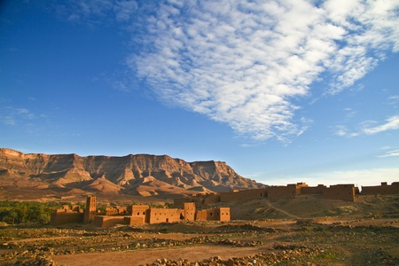 desert oasis: Panorama of the ancient moroccan kasbah Tamnougalt, in Draa Valley, one of the oldest mud-brick ksar still standing. Stock Photo