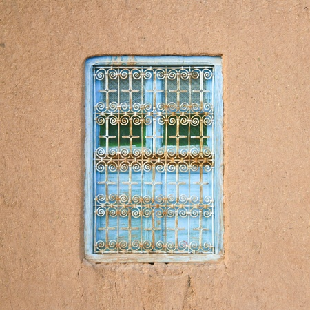 Colorful moroccan rural window with traditional pattern. photo