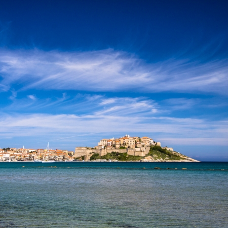 legend: Calvi - Colorful coastal town on the island of Corsica, France. According to legend, Christopher Columbus supposedly was born there.