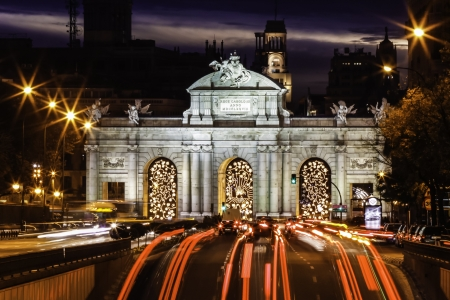 Puerta de Alcala) a neo-classical monument in the Plaza de la Independencia in Madrid, Spain. photo