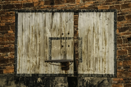 Rusty retro basketball board hanging on a brick wall. photo