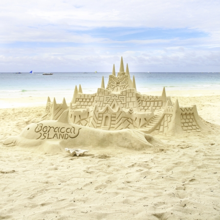Sand castle on the picture perfect white tropical sandy beach. Boracay, Philippines. photo