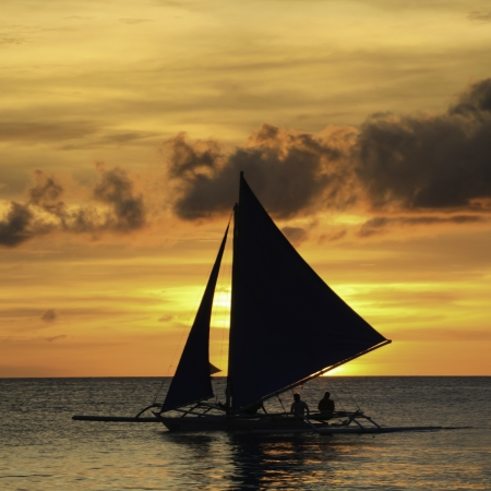 Sailboat in colorful sunset. photo
