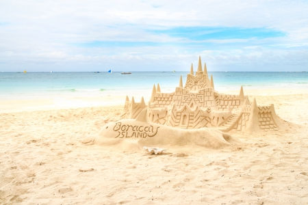 Sand castle on the picture perfect white tropical sandy beach  Boracay, Philippines