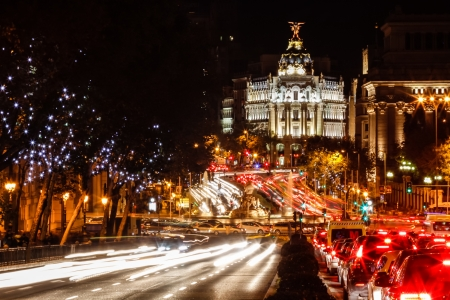 Traffic in Madrid at nigth -Plaza de Cibeles,  Gran Via and Metropolis building  Spain