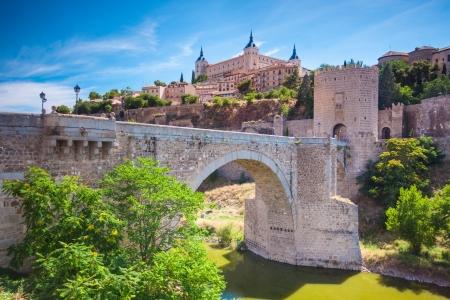 Panorama of the alcazar above the medieval San Martin bridge - Toledo, Spain Stock Photo - 15159223