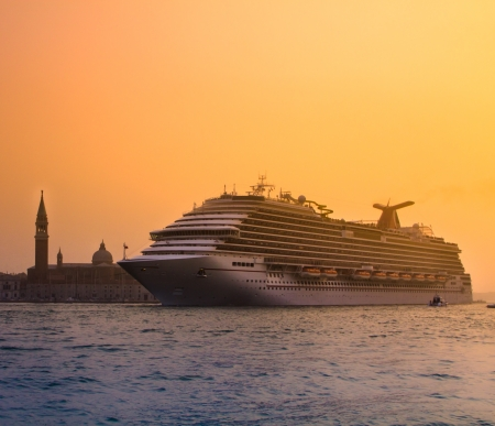 a big ship: Big touristic cruiser in romantic city of Venice in sunset  Stock Photo