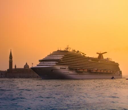 cruiser: Big touristic cruiser in romantic city of Venice in sunset  Stock Photo